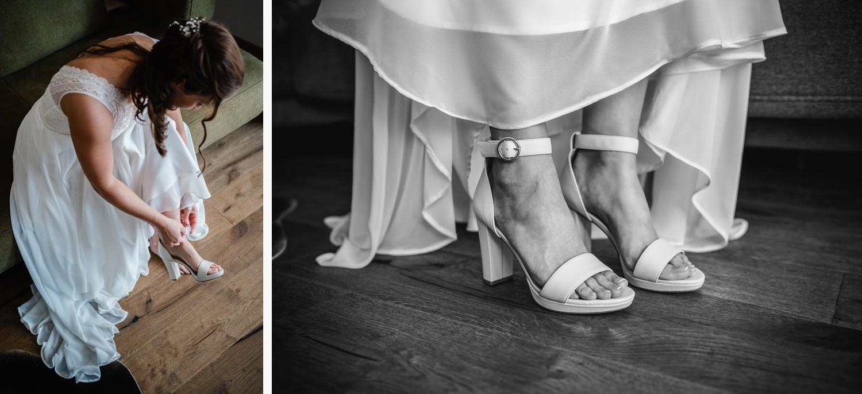 Hochzeit in Bad Birnbach, Getting Ready in Osterhofen, Braut zieht sich Ihre Schuhe an